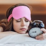 Sleeping girl with a clock