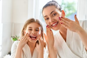 mother-and-daughter-caring-for-skin